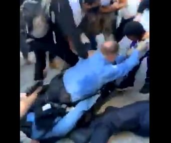 Watch: Chicago Leftist Mob Drags Police Officers Through the Streets and Kick Them in the Head